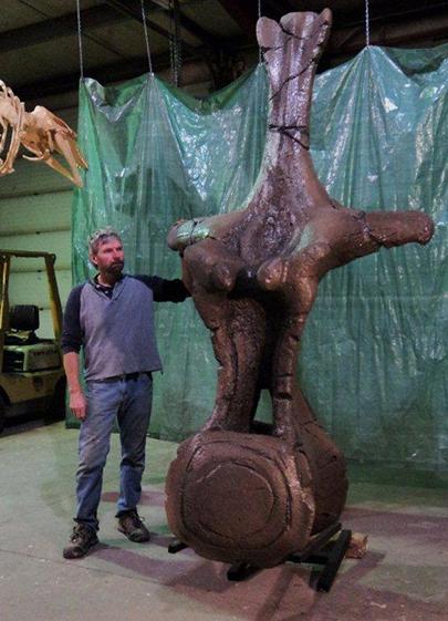 Frank Hadfield with Replica of a Titanosaurus Vertibrae